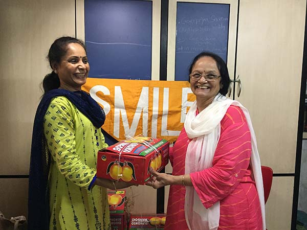 Women at UDAAN Receive Gift Hampers with Mangoes and Spices
